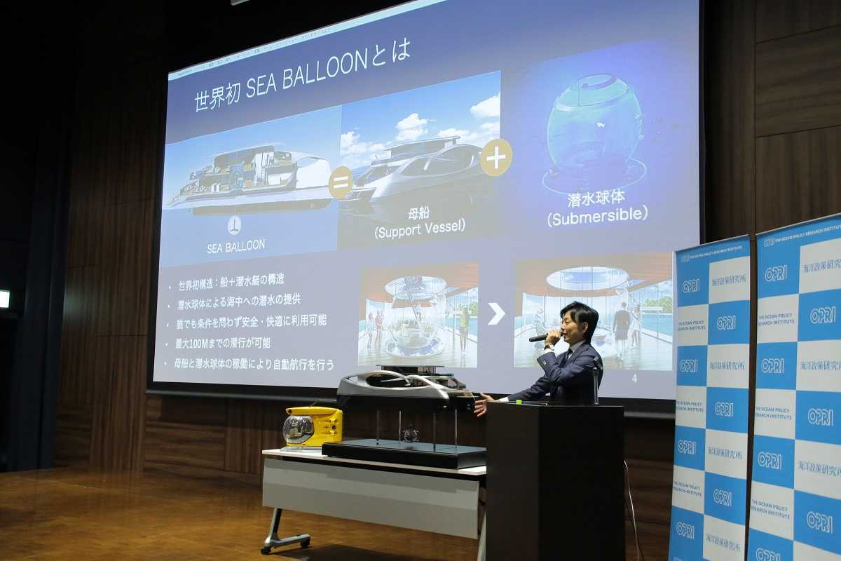 """Mr. Yonezawa explains the """"Sea Balloon"""" concept, which utilizes both a support vessel and a submersible."""