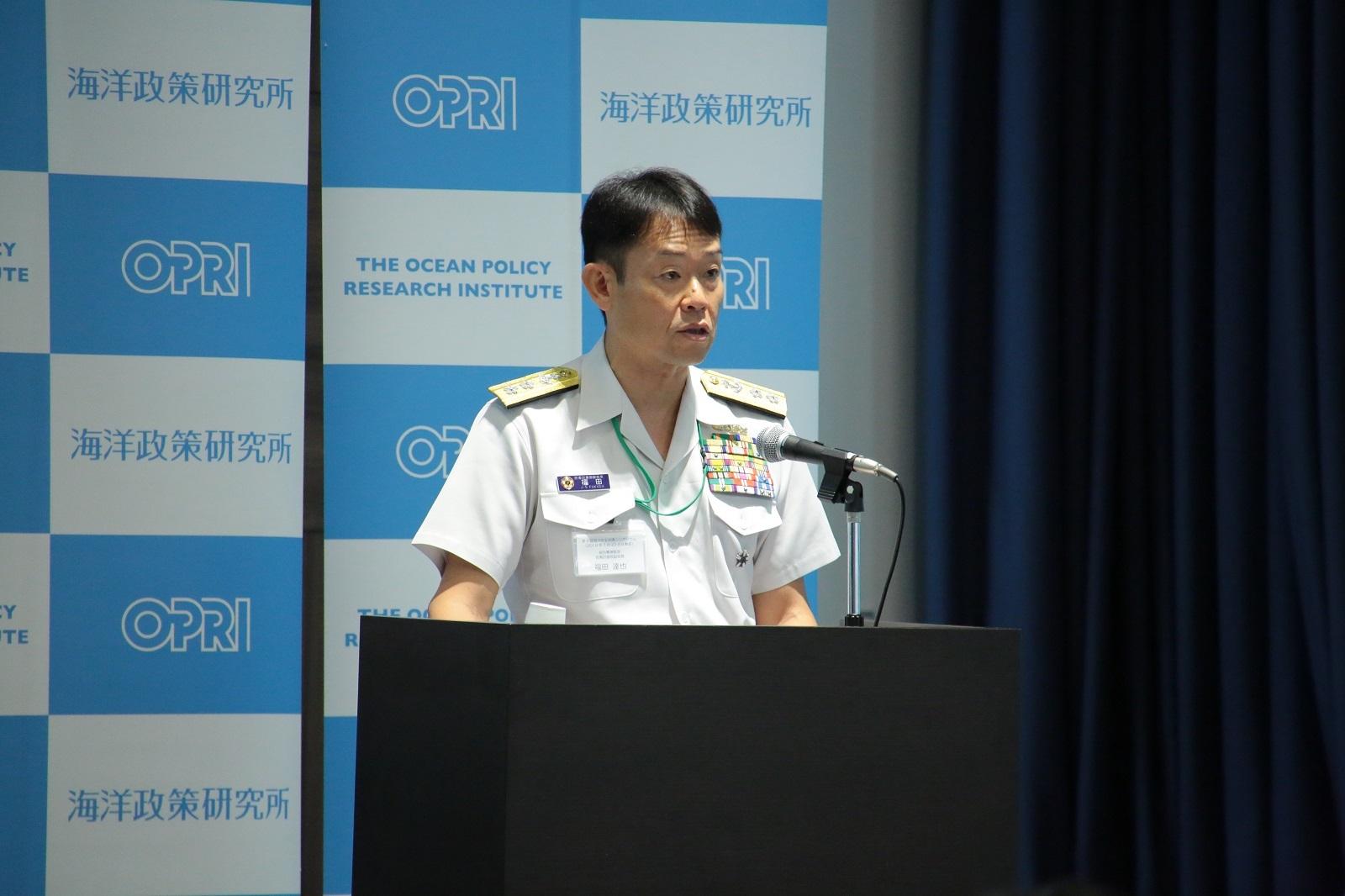統合幕僚監部防衛計画部副部長の福田達也将補による基調講演