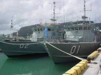 Patrol boats moored in the Micronesian harbour.